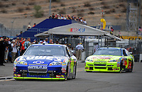Nov. 14, 2009; Avondale, AZ, USA; NASCAR Sprint Cup Series driver Jimmie Johnson (48) leads Mark Martin out of the garage during practice for the Checker O'Reilly Auto Parts 500 at Phoenix International Raceway. Mandatory Credit: Mark J. Rebilas-