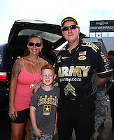 Sep 5, 2016; Clermont, IN, USA; Crew member for NHRA top fuel driver Tony Schumacher with family after winning the US Nationals at Lucas Oil Raceway. Mandatory Credit: Mark J. Rebilas-USA TODAY Sports