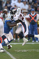 11/27/11 San Diego, CA: Denver Broncos running back Willis McGahee #23 and San Diego Chargers inside linebacker Takeo Spikes #51 during an NFL game played between the Denver Broncos and the San Diego Chargers at Qualcomm Stadium. The Broncos defeated the Chargers 16-13 in OT