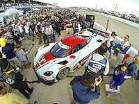 The #5 Chevrolet Corvette DP of Joao Barbosa, Christian Fittipaldi and Sebastien Bourdais on the grid before the 12 Hours of Sebring, Sebring International Raceway, Sebring, FL, March 2014.  (Photo by Brian Cleary/www.bcpix.com)