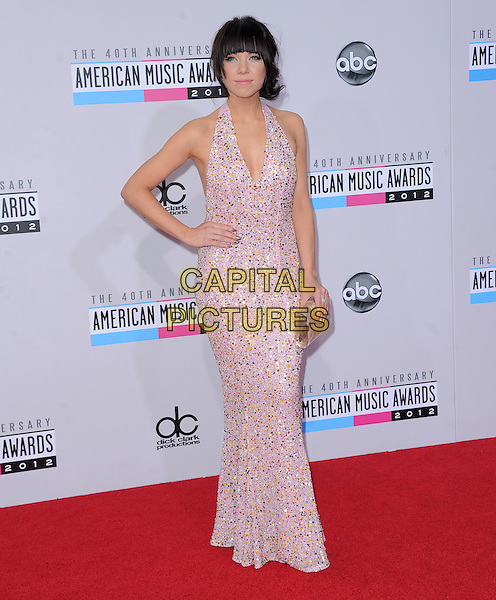 Carly Rae Jepsen.40th Anniversary American Music Awards - Arrivals held at Nokia Theatre L.A. Live, Los Angeles, California, USA..November 18th, 2012.AMA AMAs full length dress pink halterneck embellished jewel encrusted hand on hip clutch bag .CAP/DVS.©DVS/Capital Pictures.