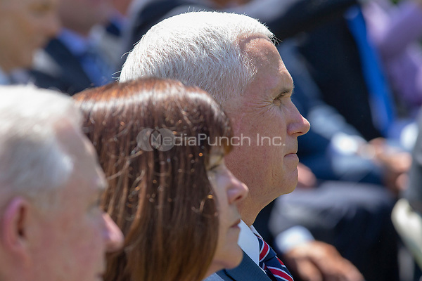 United States Vice President Mike Pence and second lady Karen Pence look on as United States President Donald J. Trump speaks at a National Day of Prayer event in the Rose Garden at the White House in Washington, DC on May 3, 2018. Credit: Alex Edelman / CNP /MediaPunch