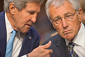 """United States Secretary of State John Kerry and U.S. Secretary of Defense Chuck Hagel discuss their testimony before the U.S. Senate Foreign Relations Committee on """"Authorization of Use of Force in Syria""""  on Capitol Hill in Washington, D.C. on Tuesday, September 3, 2013.<br /> Credit: Ron Sachs / CNP"""