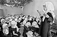 Ethnic Hazara girls study in an improvised classroom in Malastan, Afghanistan on June 21, 2002. Girls are now allowed an education for the first time since before the rule of the Taliban, but the only books available are islamic religious texts.