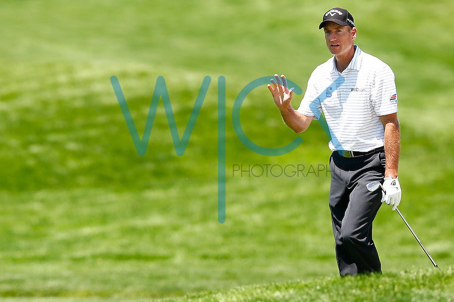 Jim Furyk reacts following his shot out of the bunker near the 18th green during the 2016 U.S. Open in Oakmont, Pennsylvania on June 17, 2016. (Photo by Jared Wickerham / DKPS)