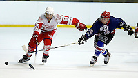 Ryan Blackwood (L) is challenged by Lewis Tribble (R) during the National Ice Hockey League South Division 2 Cup - Group B game between Haringey Racers and Slough Jets at Alexandra Palace, London on Sat Sept 13, 2014.