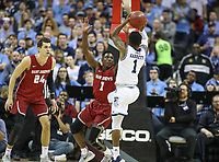 Washington, DC - March 10, 2018: Saint Joseph's Hawks guard Shavar Newkirk (1) tries to block Rhode Island Rams guard Jarvis Garrett (1) shot during the Atlantic 10 semi final game between Saint Joseph's and Rhode Island at  Capital One Arena in Washington, DC.   (Photo by Elliott Brown/Media Images International)