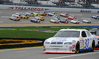 Oct. 30, 2009; Talladega, AL, USA; NASCAR Sprint Cup Series drivers draft through the tri-oval during practice for the Amp Energy 500 at the Talladega Superspeedway. Mandatory Credit: Mark J. Rebilas-