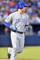 Chicago Cubs first baseman Anthony Rizzo (44) runs to first during a game against the Atlanta Braves on July 18, 2015 in Atlanta, Georgia. The Cubs defeated the Braves 4-0. (Tony Farlow/Four Seam Images)