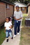 Actor/Comedian Chris Rock walks with children evacuated from Hurricane Katrina while on a visit to the Bonita House in Houston,Texas Thursday Sept. 29,2005.