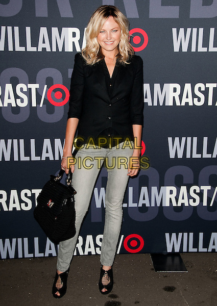 MALIN ACKERMAN.Target and William Rast Celebrate Limited Edition Collection with Private VIP Shopping event held at Factory Place, Los Angeles, California, USA..December 11th, 2010.full length black jacket jeans denim grey gray bag purse.CAP/ADM/JS.©Jay Steine/AdMedia/Capital Pictures.
