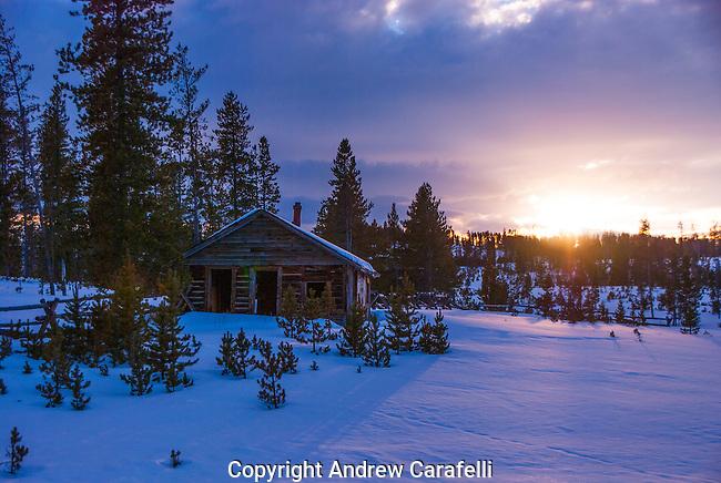 A cold sunset illuminates an old abandoned cabin near Tabernash, Colorado.
