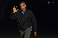 United States President Barack Obama waves as he walks on the South Lawn towards the White House after arriving on Marine One in Washington, D.C., U.S., on Monday, Nov. 21, 2016. President Obama is returning from his final foreign trip that included meetings and summits in Greece, Germany and Peru. <br /> Credit: Andrew Harrer / Pool via CNP /MediaPunch