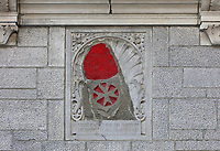 Stone carved by the Priory of the Knights of Malta, 1647, originally from the Chateau St Louis, but since 1920 has been set into the facade next to the entrance of the Chateau Frontenac, opened 1893, designed by Bruce Price as a chateau style hotel for the Canadian Pacific Railway company or CPR, in Quebec City, Quebec, Canada. The building was extended and the central tower added in 1924, by William Sutherland Maxwell. It is now a hotel, the Fairmont Le Chateau Frontenac, and is listed as a National Historic Site of Canada. The Historic District of Old Quebec is listed as a UNESCO World Heritage Site. Picture by Manuel Cohen