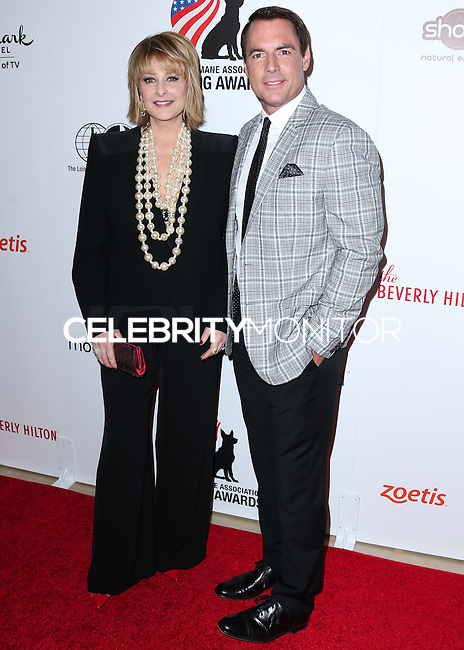 BEVERLY HILLS, CA, USA - SEPTEMBER 27: Cristina Ferrare, Mark Steines arrive at the 4th Annual American Humane Association Hero Dog Awards held at the Beverly Hilton Hotel on September 27, 2014 in Beverly Hills, California, United States. (Photo by Xavier Collin/Celebrity Monitor)