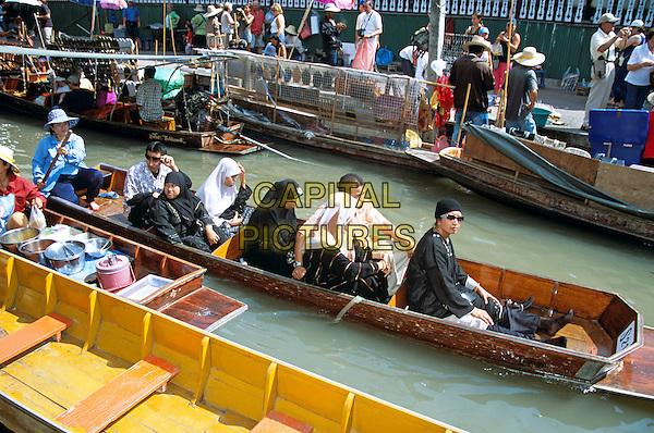 Passengers in boat, Damnoen Saduak floating market, Ratchaburi Province, near Bangkok, Thailand