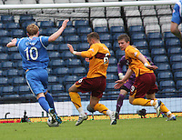 Tom Hately and Shaun Hutchinson rushing across to challenge Liam Craig