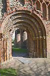 Elaborate Norman doorway of the west front of Saint Botolph's priory, Colchester, Essex, England