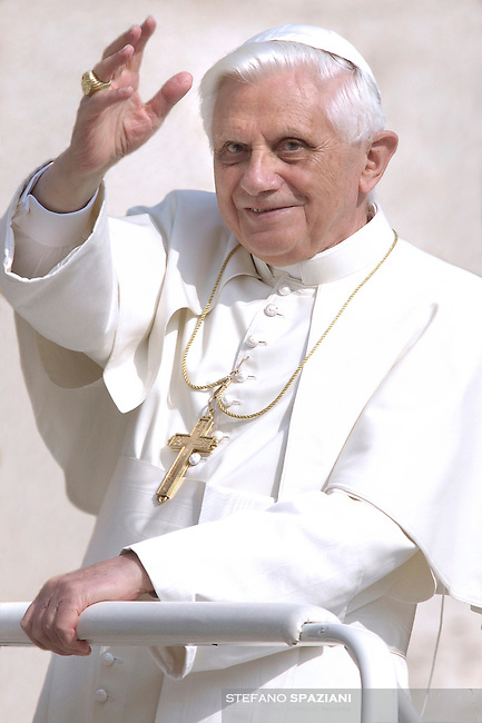 . .Pope Benedict waves to the faithful during a mass and prayer for Saint Padre Pio's faithful in St. Peter's square at the Vatican October 14, 2006.
