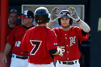 Michael Livingston #35 of the Cal State Northridge Matadors welcomes his teammate Nate Ring #7 during a game against the University of San Diego Toreros at Matador Field on March 26, 2013 in Northridge, California. (Larry Goren/Four Seam Images)