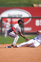 Salt River Rafters Travis Demeritte (11), of the Atlanta Braves organization, tags out Scott Heineman attempting to steal second base during a game against the Surprise Saguaros on October 17, 2016 at Surprise Stadium in Surprise, Arizona.  Surprise defeated Salt River 3-1.  (Mike Janes/Four Seam Images)