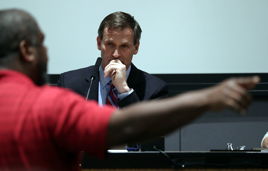 Protestors speak their minds to Mayor Mike Signer during the Charlottesville City Council meeting Monday night in Charlottesville, Va. Photo/Andrew Shurtleff