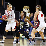 SIOUX FALLS, SD - MARCH 7:  Margaret McCloud #30 of South Dakota sets a screen for Nicole Seekamp #35 against defender Jordan Doyle #2 of Oral Roberts in the 2016 Summit League Tournament. (Photo by Dick Carlson/Inertia)