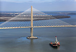 Aerial view of the The Arthur Ravenel Jr. Bridge is a cable-stayed bridge over the Cooper River in South Carolina, USA, connecting downtown Charleston to Mount Pleasant. Drum Island is seen in background