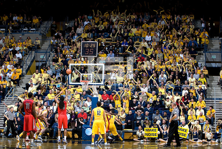 CAL fans are pictured waving their yellow foam CAL sticks to distract Arizona making free throw during the game against California at Haas Pavilion in Berkeley, California on February 2nd, 2012.  Arizona defeated California, 78-74.
