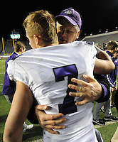 NWA Democrat-Gazette/ANDY SHUPE<br /> Fayetteville quarterback Taylor Powel celebrates with his father, Mark, after the Bulldogs' 28-7 win over Har-Ber Saturday, Dec. 5, 2015, the Class 7A state championship game at War Memorial Stadium in Little Rock. Visit nwadg.com/photos to see more photographs from the game.