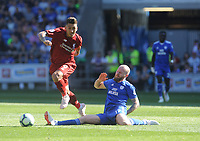 Liverpool's Roberto Firmino evades the tackle by Cardiff City's Aron Gunnarsson<br /> <br /> Photographer Ian Cook/CameraSport<br /> <br /> The Premier League - Cardiff City v Liverpool - Sunday 21st April 2019 - Cardiff City Stadium - Cardiff<br /> <br /> World Copyright © 2019 CameraSport. All rights reserved. 43 Linden Ave. Countesthorpe. Leicester. England. LE8 5PG - Tel: +44 (0) 116 277 4147 - admin@camerasport.com - www.camerasport.com