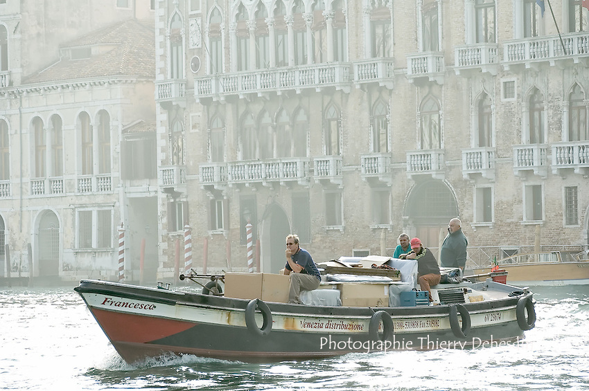 Shipping of freight on Venice on a motor boat.