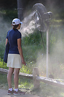 Bethesda, MD - July 1, 2017: A fan cools off during Round 3 of professional play at the Quicken Loans National Tournament at TPC Potomac in Bethesda, MD, July 1, 2017.  (Photo by Elliott Brown/Media Images International)