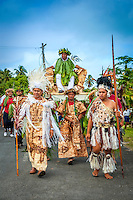 Makirau Haurua being carried on a throne as part of the celebration of his investiture with the Teurukura Ariki title, Aitutaki Island, Cook Islands.