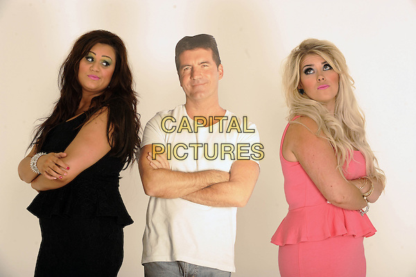'2 Shoes' duo Lucy Texeira & Charley Bird, London, .August 30th, 2012.**Exclusive. Double fees apply.**.studio x factor half length black pink peplum dress Simon Cowell cardboard cutout arms crossed side white t-shirt .CAP/FIN.©Steve Finn/Capital Pictures.