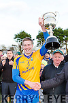 Beaufort captain Nathan Breen lifts the cup to start their celebrations after defeating  Milltown Castlemaine in the Mid Kerry final in Killorglin on Sunday