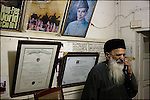 abdul sattar edhi takes one of many emergency telephone calls during his hours at his office