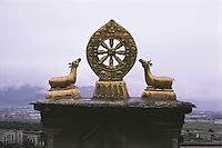 The most prominent feature on the roof of the very holy Jokhang Temple in Lhasa, Tibet is this gold Wheel of Life. The six realms of rebirth are a popular theme in Buddhist art and are often found in the Wheel of Life.
