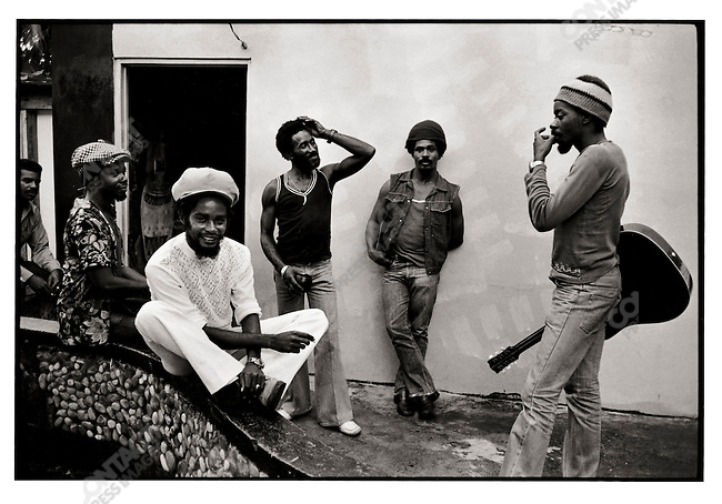 """Outside Lee :Scratch"""" Perry's studio Lto R: Mickey Boo, Max Romeo, Lee, Clancy Eccles, Chinna Smith. Kingston, Jamaica. March 1976"""