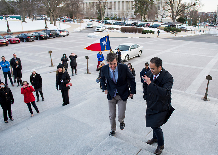 UNITED STATES - MARCH 15: Rep. Beto O'Rourke, D-Texas, left, and Rep. Will Hurd, R-Texas, walk up the House steps at the Capitol just in time for votes on on Wednesday, March 15, 2017. With flights to the Washington canceled because of Winter Storm Stella, the two Texas Congressmen rented a car for a bipartisan road trip from Texas to the Capitol. (Photo By Bill Clark/CQ Roll Call)