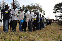 Kenyans in the Dandora neighborhood of Nairobi wait to vote at Kiambiu Social Hall on 4 March 2013. Queues of thousands of residents began to line up the night before.  .JENNIFER HUXTA / AGENCE FRANCE PRESSE / GETTY IMAGES