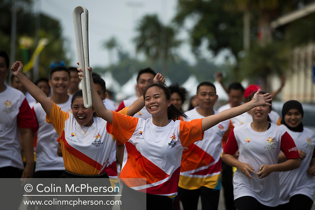 The Queen's Baton Relay spent its last full day of activities in Brunei during a four-day visit to the country. This Queen's Baton Relay will engage with all 70 nations and territories of the Commonwealth, over 388 days and cover 230,000km. It will be the longest Relay in Commonwealth Games history, finishing at the Opening Ceremony on the Gold Coast on 4th April 2018. Photograph shows a group of batonbearers taking part in the Queen's Baton Relay which took place today through the centre of Bandar Seri Begawan and the adjacent water village.
