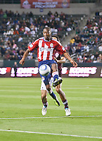 Chivas USA midfielder Michael Lahoud (11) goes up to receive the ball during the first half of the game between Chivas USA and Colorado Rapids at the Home Depot Center in Carson, CA, on March 26, 2011. Final score Chivas USA 0, Colorado Rapids 1.