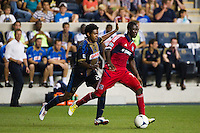 Patrick Nyarko (14) of the Chicago Fire is marked by Sheanon Williams (25) of the Philadelphia Union. The Chicago Fire defeated the Philadelphia Union 3-1 during a Major League Soccer (MLS) match at PPL Park in Chester, PA, on August 12, 2012.