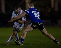 Gloucester's Will Safe is tackled by Bath Rugby's Max Lahiff<br /> <br /> Photographer Bob Bradford/CameraSport<br /> <br /> Gallagher Premiership - Bath Rugby v Gloucester Rugby - Monday 4th February 2019 - The Recreation Ground - Bath<br /> <br /> World Copyright © 2019 CameraSport. All rights reserved. 43 Linden Ave. Countesthorpe. Leicester. England. LE8 5PG - Tel: +44 (0) 116 277 4147 - admin@camerasport.com - www.camerasport.com