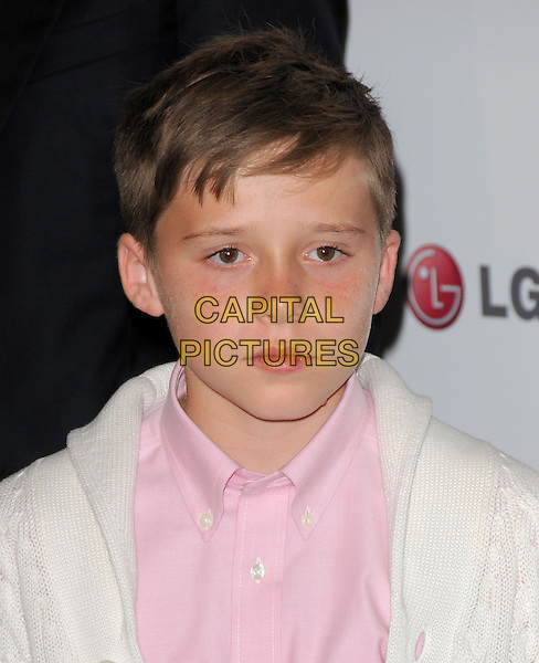 BROOKLYN BECKHAM .at A Night of Fashion & Technology with LG Mobile Phones held at SoHo House in West Hollywood, California, USA, .May 24th 2010..portrait headshot pink shirt white cream knitted knit cardigan                                      .CAP/RKE/DVS.©DVS/RockinExposures/Capital Pictures.