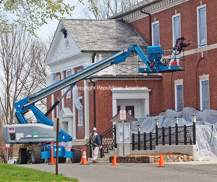 MIDDLEBURY APRIL CT- 18 APRIL 2011-041812DA01- Contractors work on repainting the exterior of Town Hall on Wednesday and  will be replacing two columns on the front of the building..Darlene Douty Republican American