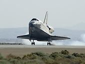 Edwards, CA - May 24, 2009 -- Space Shuttle Atlantis touches down on Runway 22 at Edwards Air Force Base May 24 to conclude its almost 5.3-million-mile STS-125 mission to upgrade the Hubble Space Telescope. .Mandatory Credit: Carla Thomas - NASA via CNP