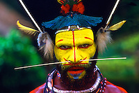 Colorful Huli Wigmen w/ Yellow Face In Papua New Guinea..
