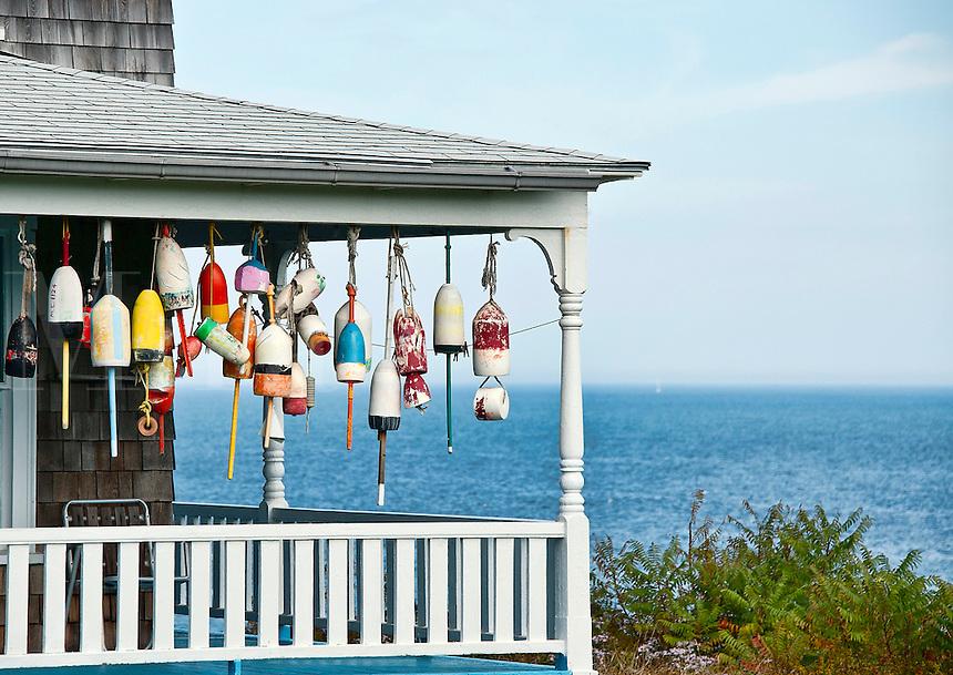 Decorative buoys on waterfront porch, York, Maine